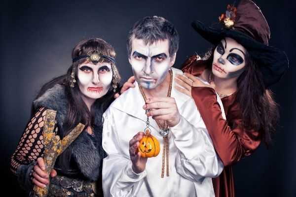 01 three adults dressed halloween costumes