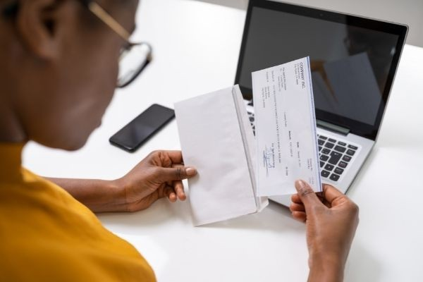 answer-to-question-what-is-your-salaryamerican-african-holding-paycheck-payroll-check